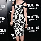 Lily Collins paired red shoes with her black-and-white dress.