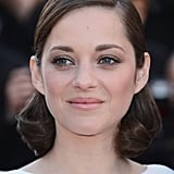 Something about Marion Cotillard's tight curls strikes our fancy: both her hair and makeup were flawless at the premiere of The Immigrant.