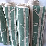 Suitable for a baby girl or boy, Sewn Natural's Woodland Birch Blanket ($53) is constructed from organic cotton, and is so crisp in a soft aqua and white color palette.