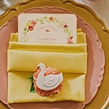Each place setting had a custom-designed swan cookie from Frog Prince Cake and Cookie Design.