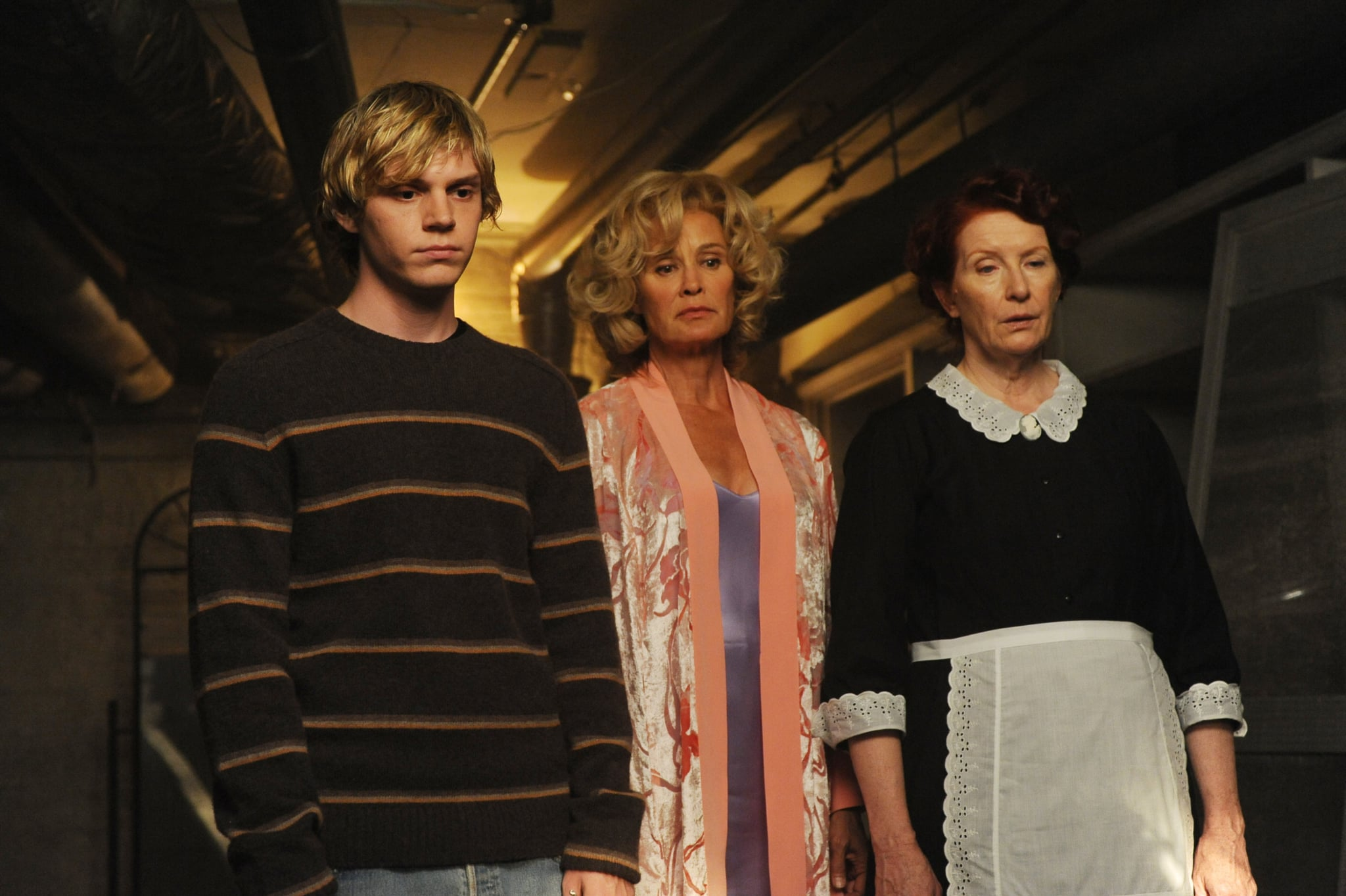 AMERICAN HORROR STORY: MURDER HOUSE, (from left): Evan Peters, Jessica Lange, Frances Conroy, 'Home Invasion', (Season 1, ep. 102, aired Oct. 12, 2011), 2011-. photo: Ray Mickshaw /  FX Network / Courtesy: Everett Collection