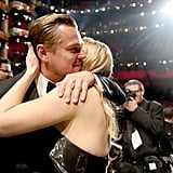 Leo got a giant hug and kiss from his BFF, Kate Winslet.