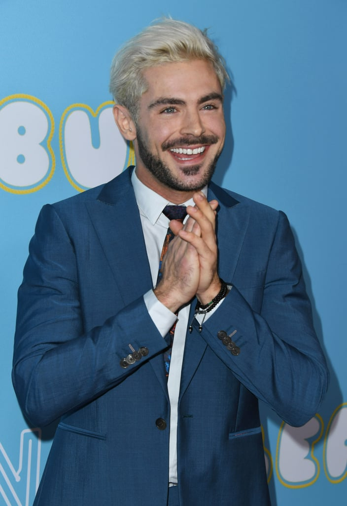 "Zac Efron looked all sorts of sexy when he attended the LA premiere of The Beach Bum on Thursday night. The 31-year-old actor sported his now-signature platinum-blond hair and cut a suave figure in a blue suit. OK, Zac, we see you! He was joined by the rest of the film's cast including Matthew McConaughey, Snoop Dogg, and Isla Fisher. The comedy — which is out in theatres now — revolves around Matthew's character, Moondog, who is a poet simply trying to ""uncover his connection with the world"" through some very unusual means. Earlier this week, we got a glimpse of what we can expect when Snoop and Matthew dropped by Jimmy Kimmel Live!, and let's just say, your stomach will hurt from all the laughing you'll be doing."