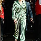 In striped silky pajamas, Gigi manages to keep her look elevated with a pair of ankle-strap stilettos.
