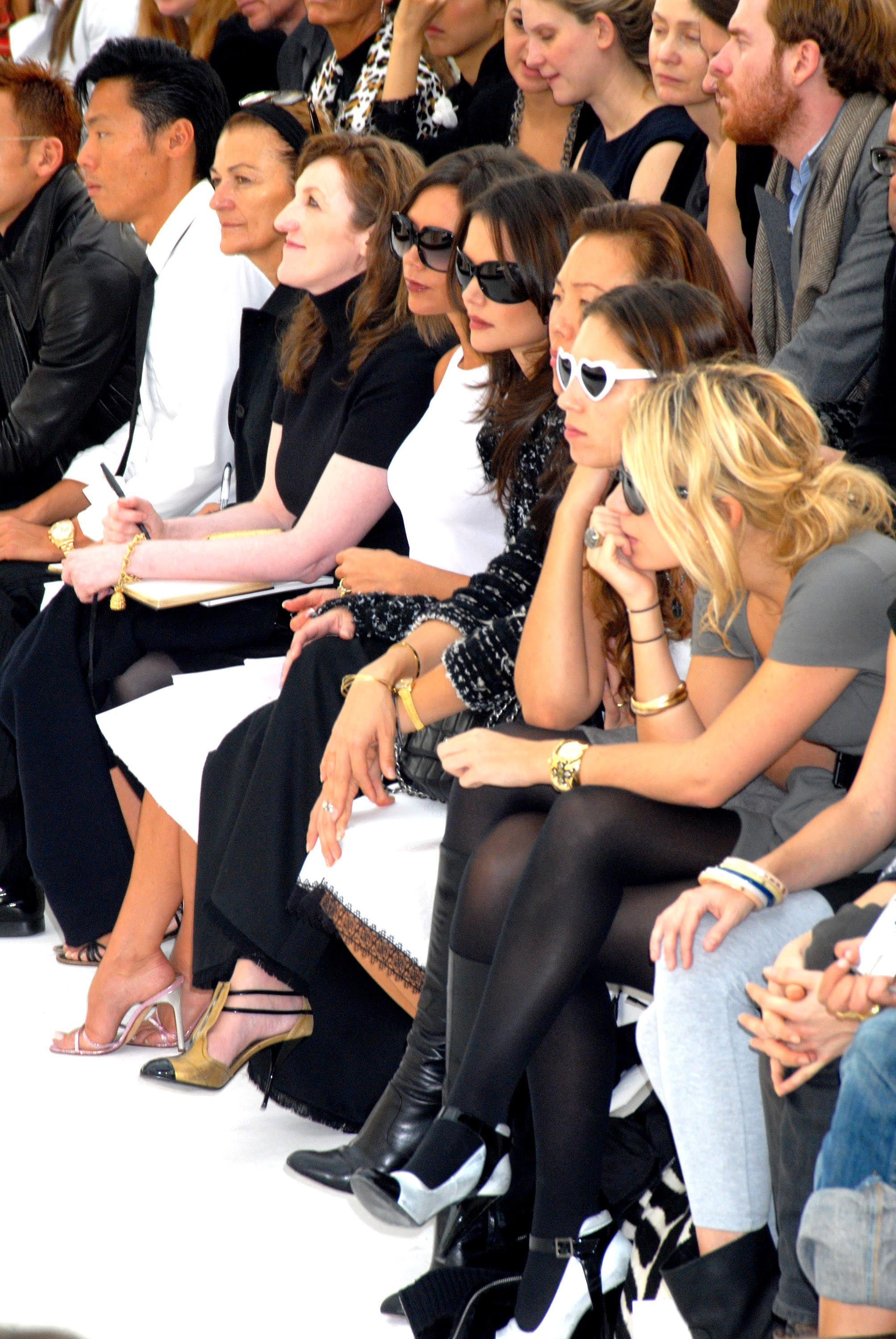 Victoria Beckham and Katie Holmes blended in for Chanel's October 2006 Paris presentation.