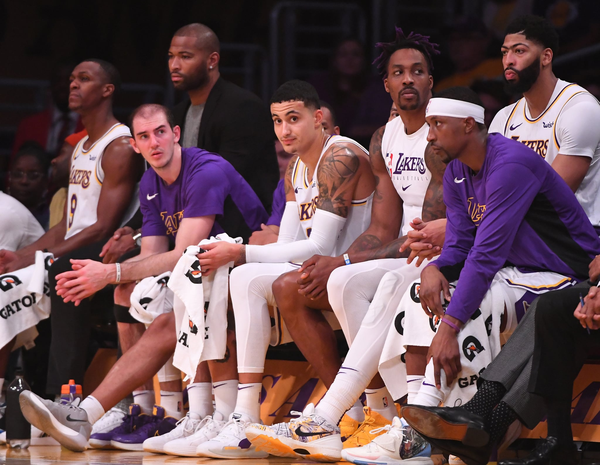 LOS ANGELES, CA - DECEMBER 22: Alex Caruso #4, Kyle Kuzma #0, Dwight Howard #39, Anthony Davis #3 and Kentavious Caldwell-Pope #1 of the Los Angeles Lakers sit on the bench in the fourth quarter of the game against the Denver Nuggets at Staples Center on December 22, 2019 in Los Angeles, California. NOTE TO USER: User expressly acknowledges and agrees that, by downloading and/or using this Photograph, user is consenting to the terms and conditions of the Getty Images License Agreement. (Photo by Jayne Kamin-Oncea/Getty Images)