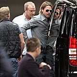 Brad Pitt hops out of his car.