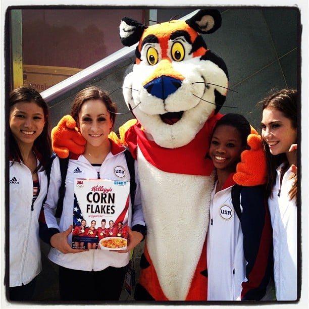 The US gymnastics team posed with their just released Corn Flakes boxes and Tony the Tiger. Source: Instagram user jordyn_wieber