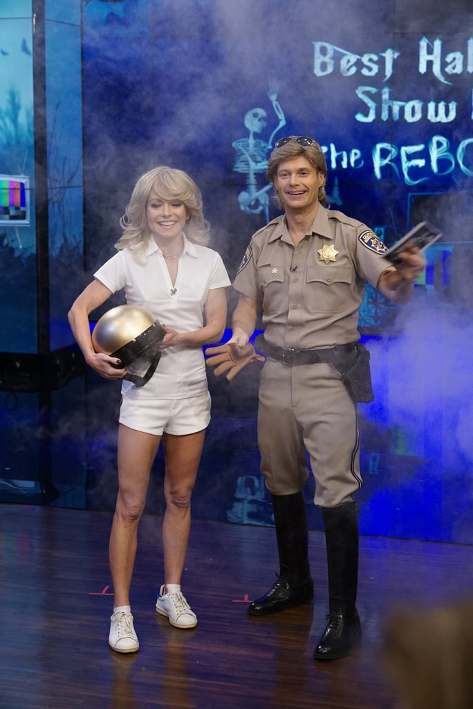Kelly Ripa recreates Farrah Fawcett's iconic Charlie's Angels look, and Ryan Seacrest dresses as Larry Wilcox's character from CHiPs.
