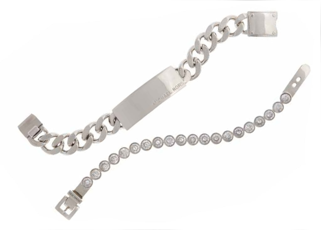 Silvertone ID Plaque Chain Bracelet, $85; Silvertone Tennis Bracelet with Clear Crystals, $125