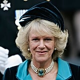 Camilla's aquamarine The Duchess has a penchant for chokers, and inherited this one from her mother, featuring three strands of pearls and a whopping aquamarine centerpiece.