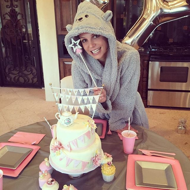 """Wednesday marked a special day for Britney Spears: her 34th birthday! In honour of her big day, the singer had a birthday party fit for a queen (tiara included) and took to social media to document the fun. In one of the photos, Britney showed off her supercute teacup cake while wearing an adorable bear robe, writing, """"Thank you so much for all the birthday wishes today! I loved reading them just as much as I loved my teacup cake,"""" along with a cake emoji. The pop princess also received a very special gift from pal Miley Cyrus: balloons that spelled out her name, which she thanked Miley for on Instagram.  On top of ringing in her 34th, Britney has also already started celebrating Christmas. Although she won't be performing at Rockefeller Center this year, Britney was given the honour of flipping the switch at a Christmas-tree-lighting ceremony at The LINQ Promenade in Las Vegas in November. Keep scrolling to see the snaps, then check out these pictures of Britney that will really take you back in time."""