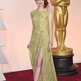 Glittering in gold Elie Saab at the 2015 Oscars.