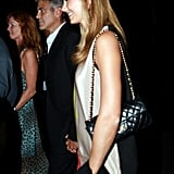 Stacy Keibler held hands with George Clooney.