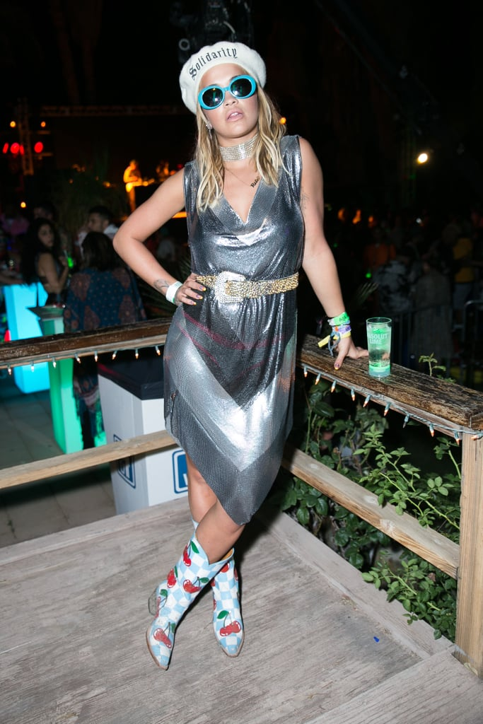Rita Ora wearing a slinky slip dress and cherry boots at the Moschino x Candy Crush Desert party.