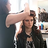 Kayla got a touch up before her photo shoot.  Photo courtesy of CW