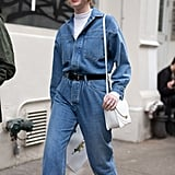 Create the illusion of double denim by belting a jumpsuit or romper. Sleek accessories ensure a polished result.