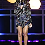 Wearing an embellished minidress that featured long sleeves.
