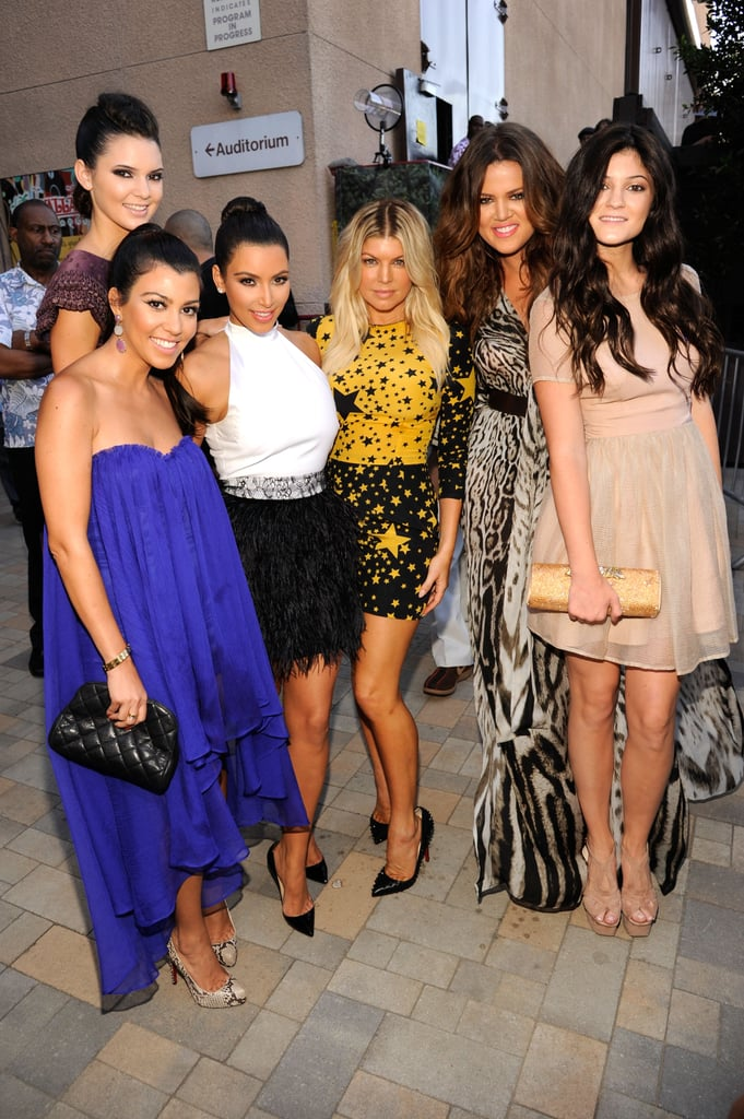 Kim, Khloe, and Kourtney Kardashian along with their younger sisters, Kylie and Kendall Jenner, stepped out in an array of color and glamour for tonight's Teen Choice Awards in LA. Khloe was joined by her husband and Laker all-star, Lamar Odom, and his children, Lamar Jr. and Destiny. Kim's back from NYC where she was spotted late last week tending to wedding details and a last-minute dress fitting with her bridal designer Vera Wang. She's quickly approaching her Aug. 20 wedding date, and the whole family is gearing up for the big day. Fergie, who is one of the many celebrities rumored to be on Kim's star-studded wedding guest list, joined the Kardashians on the blue carpet to pose for a photo wearing Dolce & Gabbana. Kim and Fergie share a love of fashion, and Fergie's yellow and black graphic starred minidress bares a similar resemblance to a gown Kim recently modeled during a high-fashion photo shoot. Stay tuned for more updates from the show and be sure to vote on all of Fab and Bella's fashion and beauty polls!