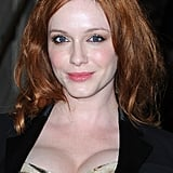 Christina Hendricks gave a smile at the Versace show for Paris Fashion Week.