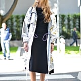 With a Metallic Coat and Simple Black Dress