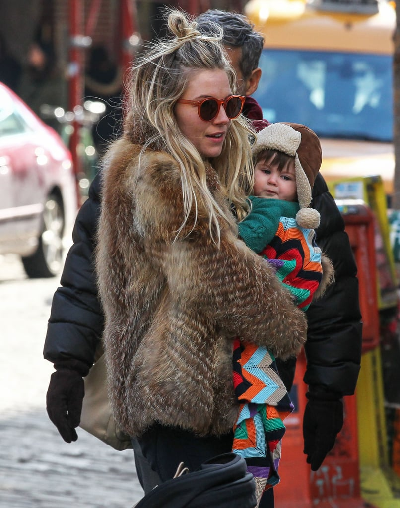 Sienna Miller wore her hair up and donned a fur coat this afternoon to take her little girl, Marlowe Sturridge, to a park in NYC. Marlowe and Sienna headed to the US after a stint at home in England. Over the last few weeks, Sienna was in London to support her nearest and dearest. She attended the launch of her sister Savannah Miller's Spring/Summer 2013 Savannah collection and was also in the cheering section for her fiancé and Marlowe's dad, Tom Sturridge, in No Quarter, his new play. It ran from mid-January until last Saturday, Feb. 9. Sienna still fit in a mid-January jaunt to LA. Sienna wore Erdem to the Golden Globes, where she was nominated for best actress in a miniseries or made-for-TV movie thanks to her part in The Girl, though she did not win.