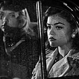 It's a rainy night for Aria (Lucy Hale) and Hanna (Ashley Benson). Source: ABC Family