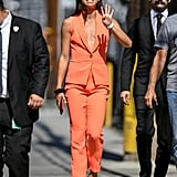 Alex Morgan's Orange Suit and Silver Heels July 2019