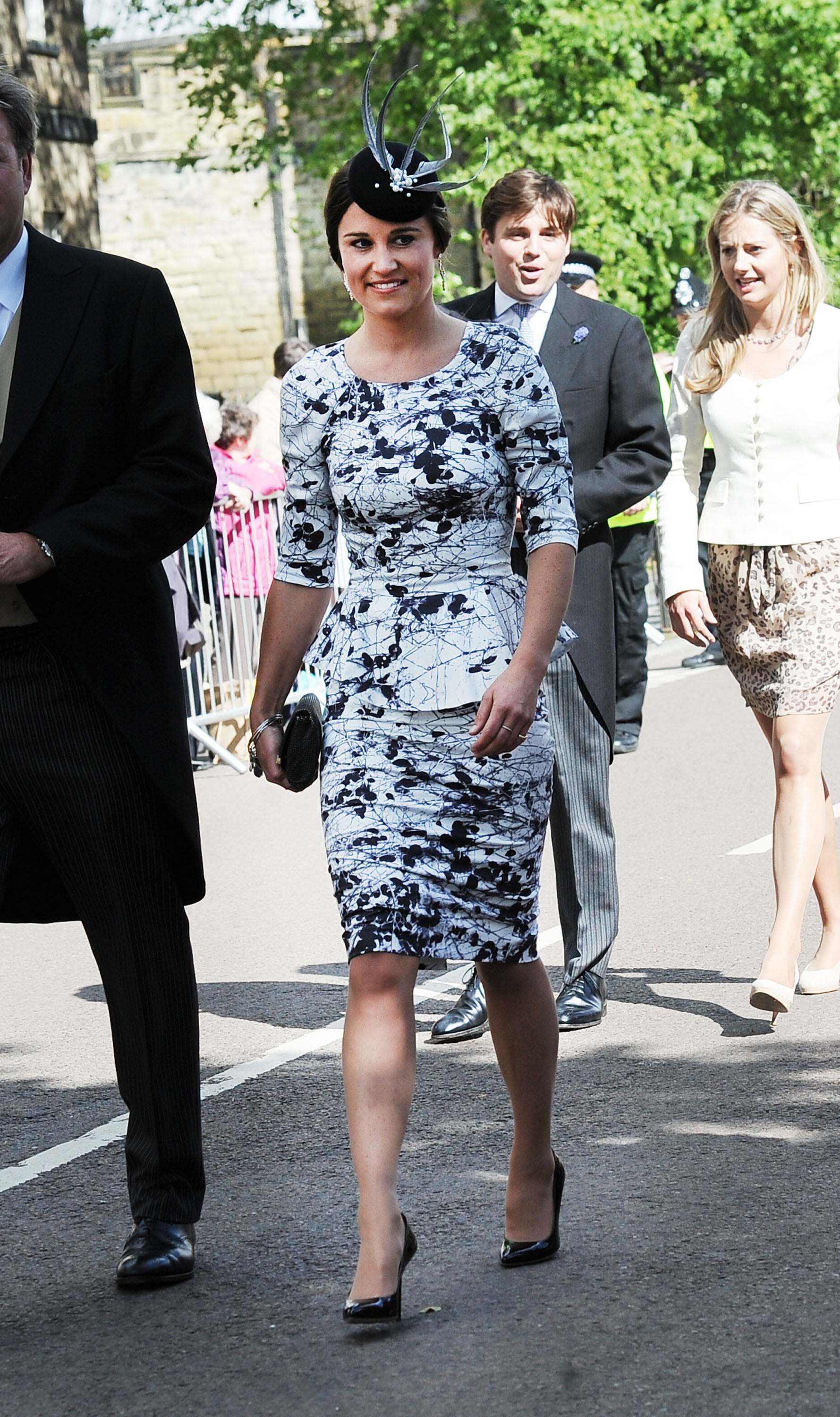 Pippa Middleton showed off her famous curves in a Tabitha Webb peplum dress then added a fancy fascinator at Melissa Percy and Thomas Van Straubenzee's wedding in the UK in June. We love her black-and-white palette and think it's totally appropriate for a black-tie wedding. The fascinator is optional but would give you that British touch.