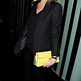 Kate Moss added interest to an all-black menswear-inspired style with a pastel clutch.