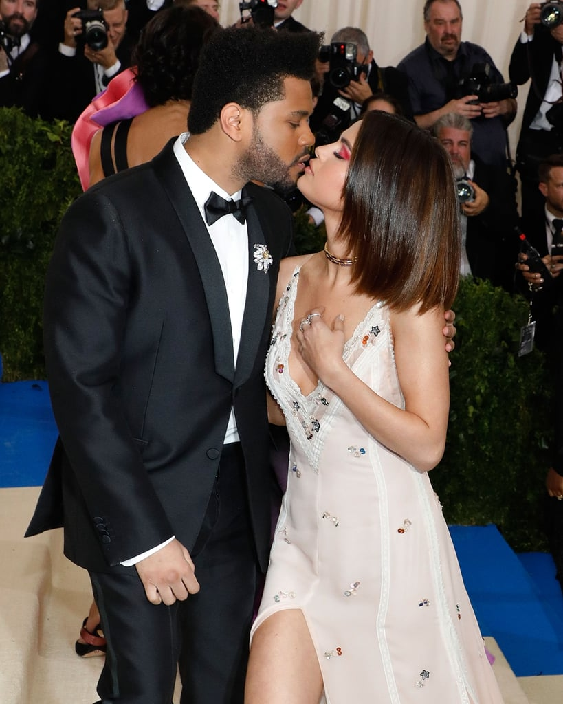 Selena Gomez and The Weeknd are getting more and more comfortable with showing off their love for the cameras. Shortly after making their relationship Instagram official at Coachella, the couple made their red carpet debut at the Met Gala in NYC on Monday. While The Weeknd looked dapper in a tux and tie, the 13 Reasons Why executive producer looked beautiful in a flowing white Coach gown and purple eye shadow. Aside from posing for the flashing cameras, the two also snuck in a little PDA as they pulled each other in close for a hug. They looked like something right out of a wedding magazine!      Related:                                                                                                           At the Met Gala, Bella Hadid Shows Us Once Again How to Be Unbothered by an Ex