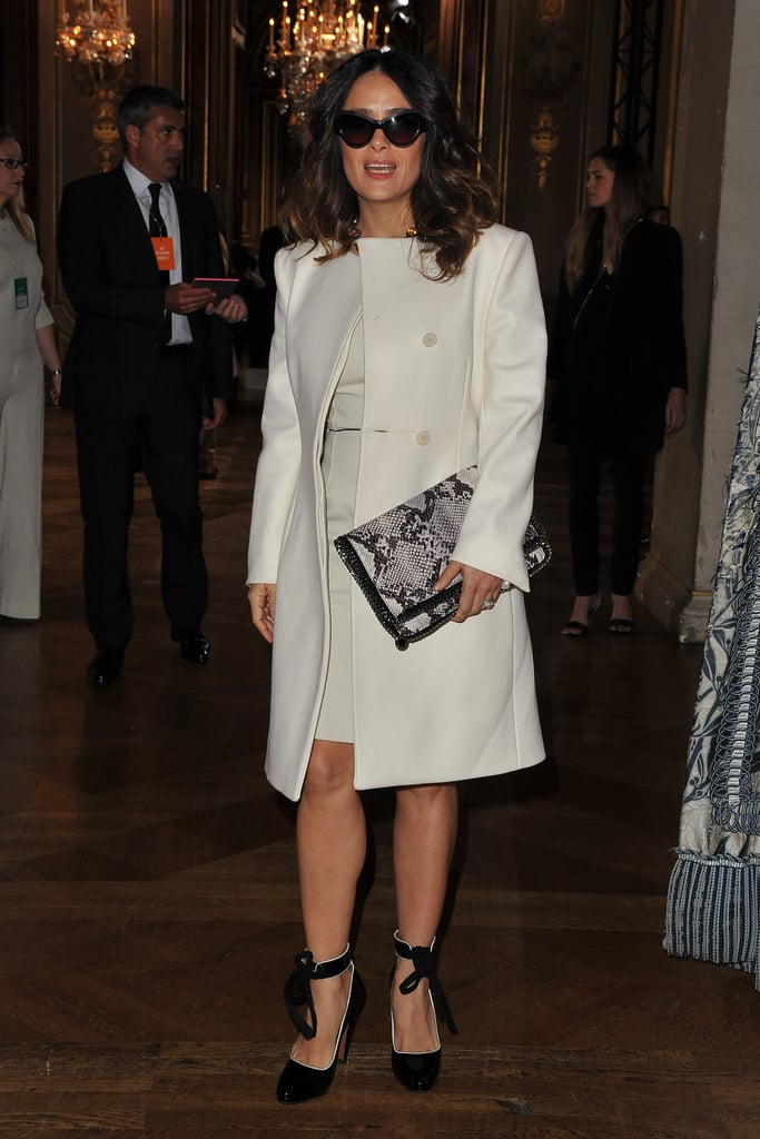 Salma Hayek went for an all-white look, topped off by ballerina-inspired heels, for Stella McCartney's Fall '12 show.