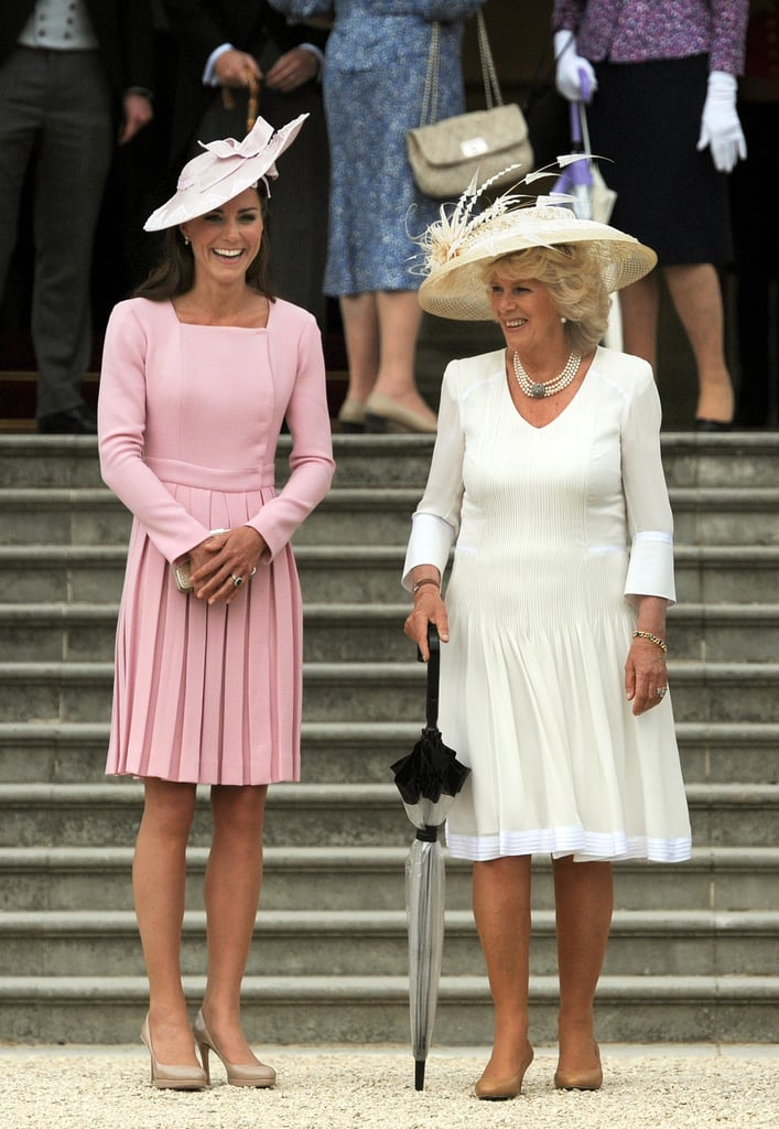 Kate Middleton, in matching pinks, and Camilla Parker Bowles, in all white, attended a garden party at Buckingham Palace in May 2012.