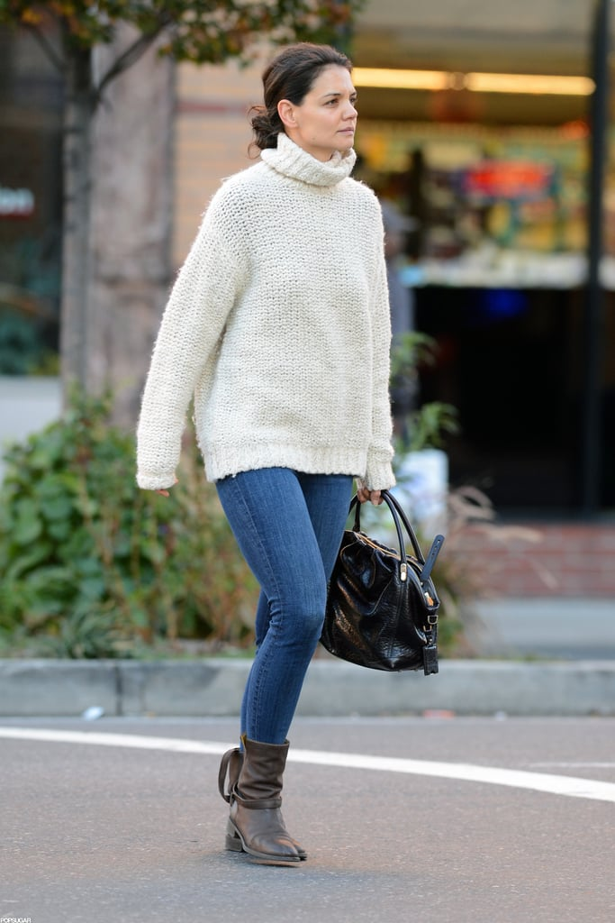 Katie Holmes paired a cozy white turtleneck, skinny jeans, and rugged boots for a classic Fall outfit while out in NYC.