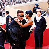Alec Baldwin carried Hilaria Thomas into the opening ceremony and Moonrise Kingdom premiere.