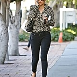 Styling her jeans with a chic leopard-print top in 2012.
