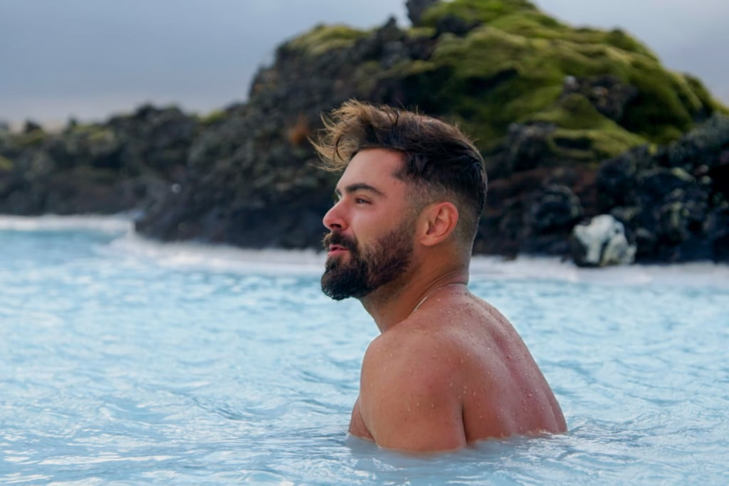 Efron, in his natural element, takes in the views of Iceland as his hair blows in the wind.