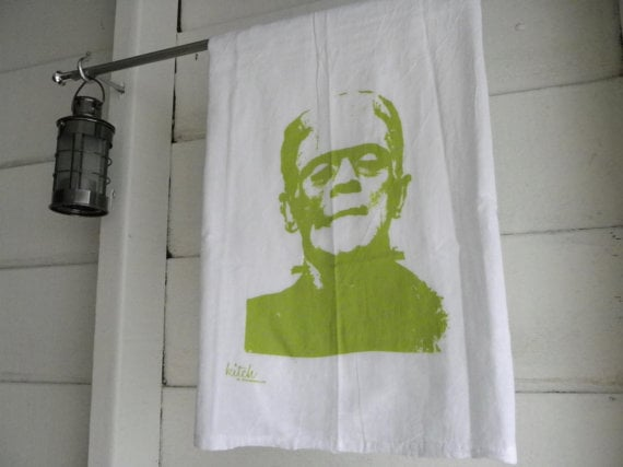 printed in ectoplasm green on a cotton tea towel