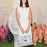 Lana Del Rey wore Mulberry's Embroidery Dress in White Cotton, carried the Del Rey in White Mini Gecko Print, and donned the Mulberry Signature Mid Heel Pumps in Biscuit Brown from the Spring Summer 2013 Collection.