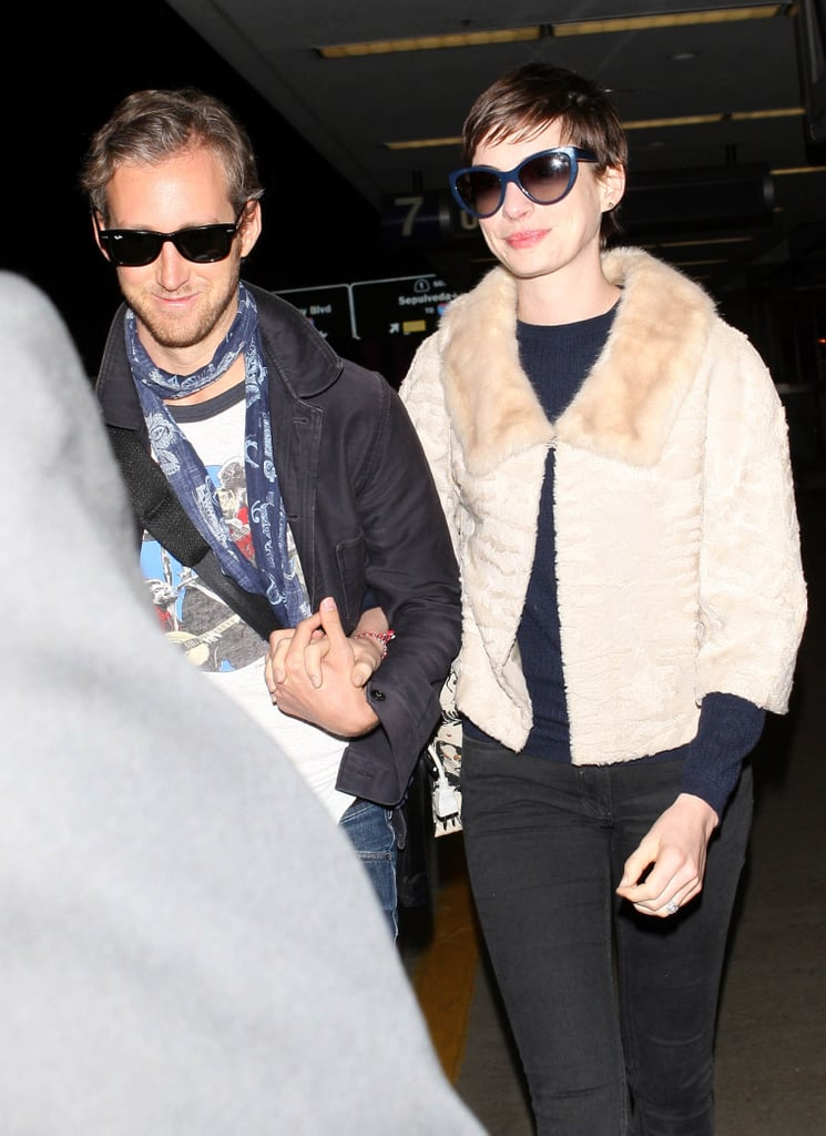Anne Hathaway and Adam Shulman were smiling big when they touched down at LAX last night. Newlyweds Anne and Adam tied the knot last month, on Sept. 29, in an intimate ceremony in Big Sur, CA — see photos from Anne Hathaway's wedding! She wore a lavish gown designed by her friend Valentino. Anne and Adam hung out around LA for a few days following the nuptials, but took off for their honeymoon about four days later. According to reports, Anne and Adam honeymooned in Europe, making stops in London, Paris, and beyond.
