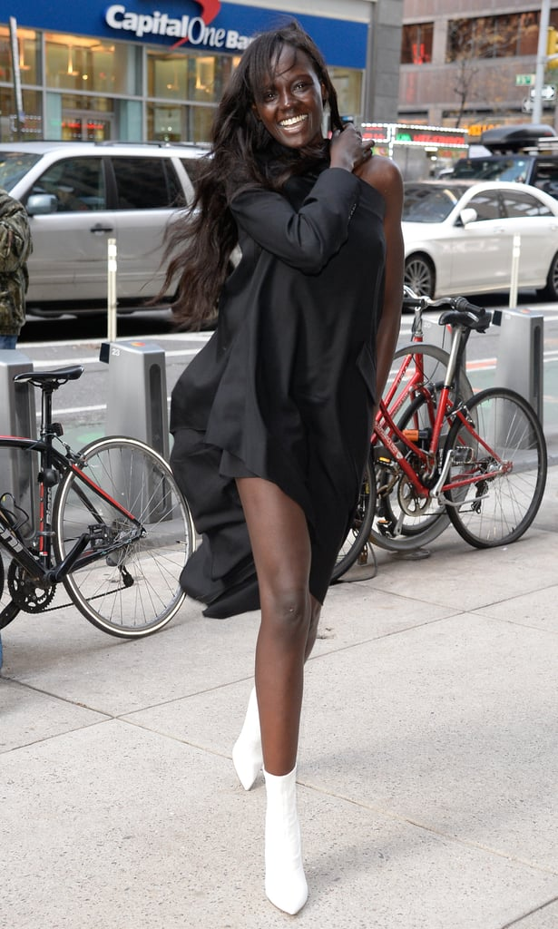 8adf52a1ec3 Duckie Thot styling her black minidress with white boots ...