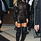 Wearing a sparkling Tom Ford mosaic mini and thigh-high boots for her album release party in 2013.