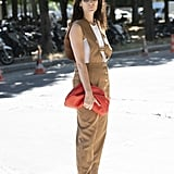 Make a jumpsuit look more street style friendly with a red Bottega clutch.
