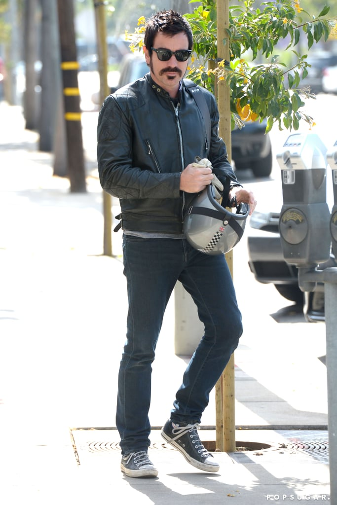 Ewan McGregor looked nearly unrecognizable yesterday when he ran errands in West Hollywood. He sported a new, darker hair color, a thick goatee, and huge sideburns as he drove his vintage motorcycle around town. Ewan's new look may be for his new film Jane Got a Gun, which he signed on for earlier this month. Ewan joined Jane Got a Gun for the pivotal villain role, which Bradley Cooper was forced to turn down after April's Boston Marathon bombings disrupted his filming schedule for American Hustle. Natalie Portman and The Great Gatsby's Joel Edgerton will costar in the project alongside Ewan. Even though it is just for a new movie, we can't help but think that Ewan looks like the long-lost brother of Justin Theroux with his bad-boy makeover.