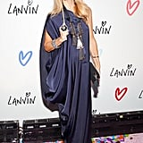 Rachel Zoe wowed in a loose-fitting Grecian gown and fancy masquerade mask at the Lanvin party.