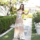 Alessandra Ambrosio smartly completed her Ale by Alessandra halter maxi dress with layers of gold jewels from her own collection with Bauble Bar.