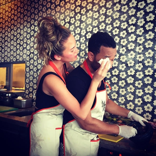 """Chrissy hilariously wiped John's tears as the couple chopped onions during a cooking class in December 2014. She captioned this snap, """"Cooking class with el sensitivo."""""""