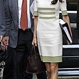 Amal's cream sheath dress by Camillo Bona Haute Couture comes straight off the runway.