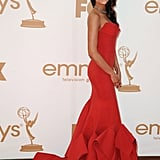 Nina Dobrev wore a strapless red gown to the 2011 Emmy Awards.