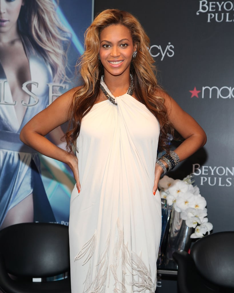 Pregnant Beyoncé Knowles in a white Lanvin gown.